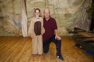 Junior Reporter, Claudia, in her role as Seaman the Dog, pictured with teacher and playwright Jeff Lantos. Photo: Nicola Buck