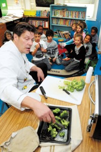 Johnny Prep prepares freshly picked broccoli with second graders at Marquez Charter School.   Rich Schmitt/Staff Photographer