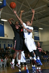 Junior guard Aaron Johnson drives for a layup during a January 14 game against Westchester.    Photo by Rich Schmitt, Staff Photographer