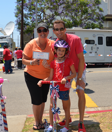 First-place bike winner was Julie Kassin with her parents Stacy and Woody.