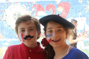 Students at Le Lycée Français de Los Angeles celebrate the French language by posing in French berets and mustaches. Photo courtesy of Le Lycée Français de Los Angeles