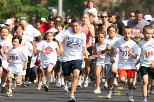 The 19th Annual Kids' Fun Run on the Fourth of July is open to all kids 10 years old and under. Whether you walk or run, it is all for fun. Rich Schmitt/Staff Photographer