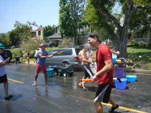 A water war breaks out on Monument St. Photo courtesy of John Beaver