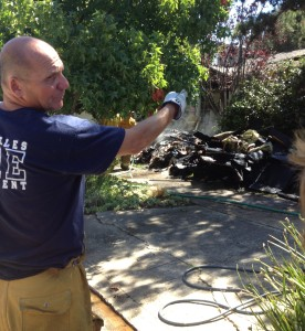 A firefighter directs during the knock down of a house fire on Las Casas Avenue in Pacific Palisades on July 23, 2014. Credit: Nancy Jackson