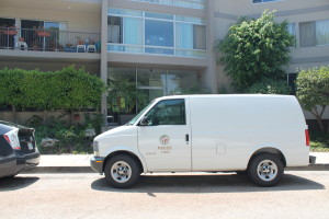 An LAPD van parked outside 111 Marquez Pl. on Monday, Aug. 11 where an elderly woman was kidnapped and carjacked.