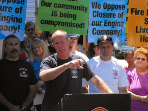 By Reza Gostar Frank Lima wears Palisades Baseball hat as he stands in support of Fire Engine 69 near Sunset.