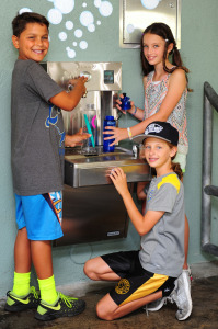 Diego Sosa, Ally Preminger and Gracie Preminger fill up at the new water fountain installed at Canyon School. Rich Schmitt/Staff Photographer