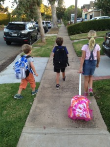 Younger brother Rhys Grandy joins Annabelle and Teddy on the way to school.    Photo: Sage Grandy