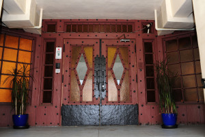 """The building's front doors, heavy and wooden, have original stained glass etched with the word """"Joya's"""" for Jewel """"Joya"""" Carmen. Rich Schmitt/Staff Photographer"""