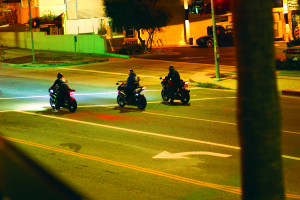In May 2015, motorcyclists rode in packs of three to five as they left the 76 gas station. Photo: Charles Warren