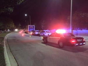 Police block the right lane of Palisades Drive during the death investigation Friday night. Photo: Eric Hoffman