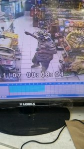 """""""The Beast"""" in security camera footage from State Beach Liquor showing him brandishing a knife."""