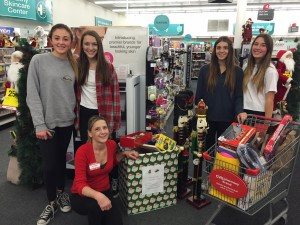 Pali High School on Wheels club members with CVS manager Sandy (kneeling) as they collect toys donated to the Palisades Cares toy drive. Photo courtesy of Palisades Cares