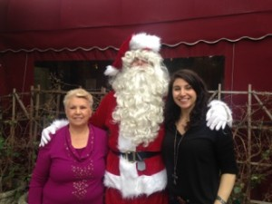 Mercedes and Vanessa Pelligrini of Vittorios with Santa (Jon Duede) at a Dec. 22 luncheon where homeless children tutored by School on Wheels were given toys from the Palisades Cares toy drive. Photo courtesy of Palisades Cares