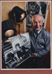 The late Albert Bresnik with one of his photos of Amelia Earhart. Photo courtesy of Randy and Ed Bresnik
