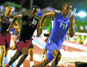 Palisades' Raynard Beckham (right) rounds the first turn on the third leg of the 4x400 relay at Buchanan High. Photo: Steve Galluzzo