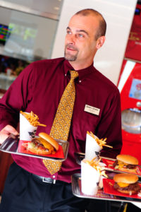 Manager Jon Price ports the Double 'N Cheese Steakburger. Photo by Rich Schmitt/Staff Photographer